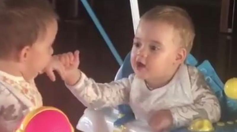 Screenshot of Yash and Roohi from their first birthday.