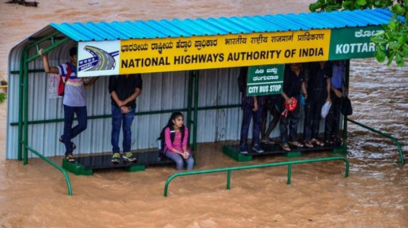 A flooded bus stop after heavy downpour in Mangaluru on Tuesday. (Photo: PTI)