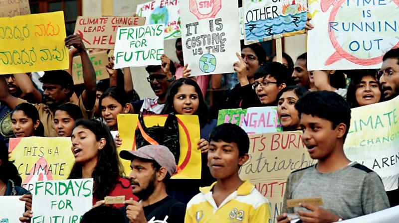 Friday For Future a movement by students take part in an awareness campaign against Global Climate Warming in front of Town Hall in Bengaluru on Friday. (Photo: Shashidhar B)