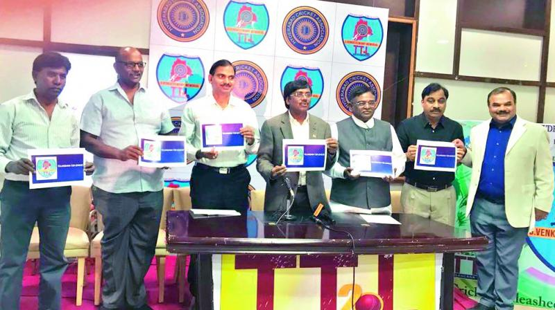 Officials hold up brochures of the Telangana T20 League (TTL) at a press conference addressed by Hyderabad Cricket Association office bearers at the Rajiv Gandhi International Cricket Stadium in Hyderabad on Tuesday.