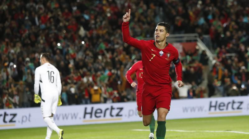 Portugal captain Cristiano Ronaldo scored another treble, moving closer to 100 international goals, as he led the European champions to a 6-0 drubbing of Lithuania in a Euro 2020 qualifier on Thursday. (Photo:AP)