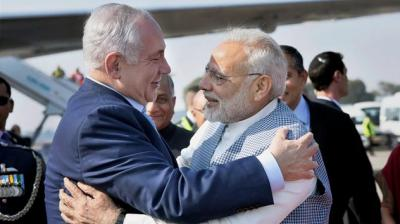Prime Minister Narendra Modi welcomes Israeli Prime Minister Benjamin Netanyahu on his arrival at Air Force Station, Palam, in New Delhi on Sunday. (Photo: PTI)
