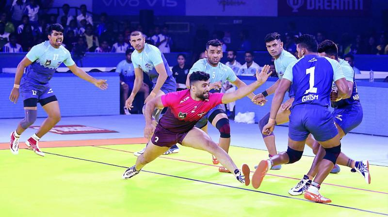 Nabibaksh of World 7 raids during the Pro Kabaddi All-Star match at the Gachibowli Stadium in Hyderabad on Sunday.