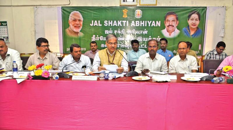 Pramod Kumar Prathap, Additional secretary, Mmnistry of Ayush, Government of India, speaking about Jal Shakthi Abhiyan, at an official meeting at Thanjavur on Saturday. (Photo: DC)