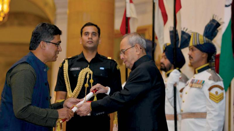 (Top) Fr. Mathew Thomas, BOSCO Executive Director receiving National Award for Child Welfare 2014 from former President Pranab Mukharjee in 2015 (Right) Children at BOSCO being mentored by volunteers (Image: DC)
