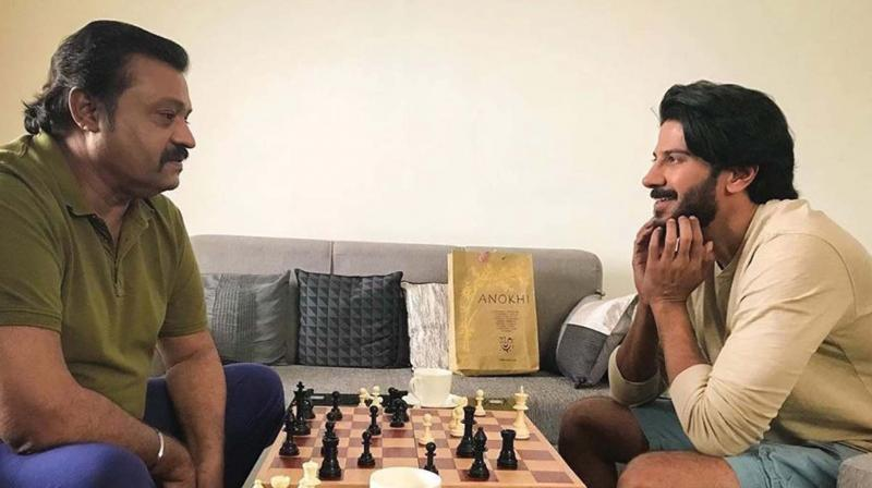 DQ took to his Instagram handle and shared a candid picture of him playing chess with Suresh Gopi.