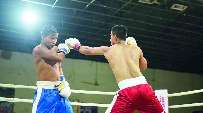 Ashini Kumar Sharma defends against Robinson.