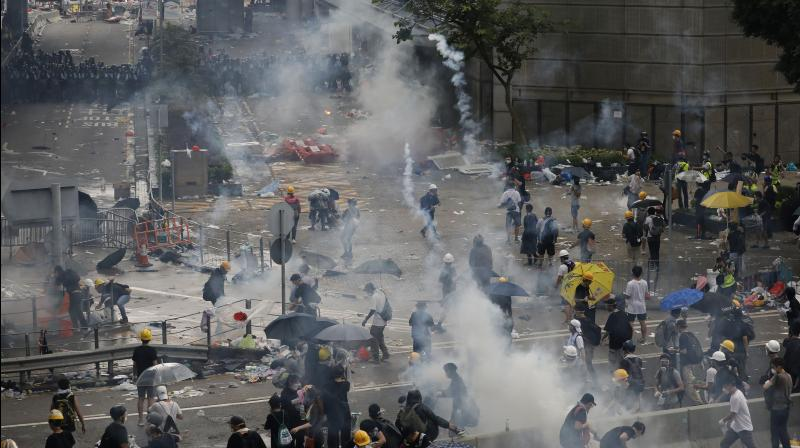 Police fired rubber bullets and beanbag rounds at the crowds, weapons that have not been widely used in recent history. Human rights groups criticised the tough tactics, while police said they were necessary against crowds of people who broke through barriers outside government headquarters and the legislature on Wednesday. (Photo: AP)