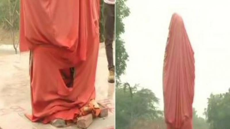 Students of the Akhil Bhartiya Vidyarthi Parishad (ABVP), to mark their protest against the defacing, arrived afterwards at the statue and lit earthen lamps and showered flowers around it. (Photo: ANI)