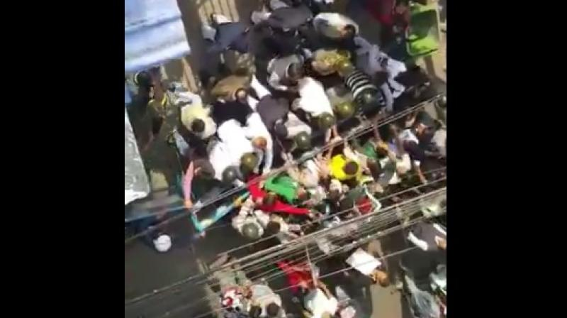 TMC goons trying to break open the gate of my apartment in Kailash Bose Street where my mum and dad are staying. What a shame, he tweeted. (Photo: Video grab)