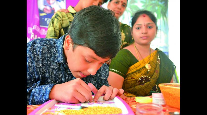 Fourteen-year-old Emmadisetty Kowshik, a student of Class 9, has taken up micro-carving of the National Anthem on tur dal in order to make a world record.