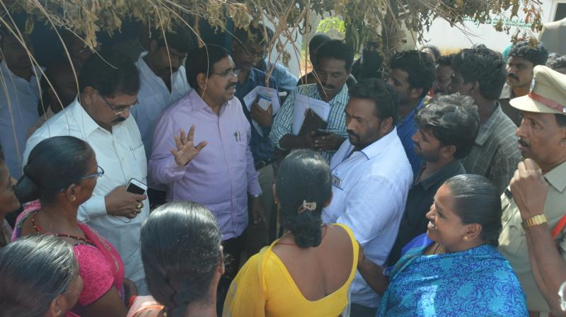 Municipal administration minister P. Narayana seen interact with people in Kottur village in Nellore city on Wednesday. (Photo: DC)
