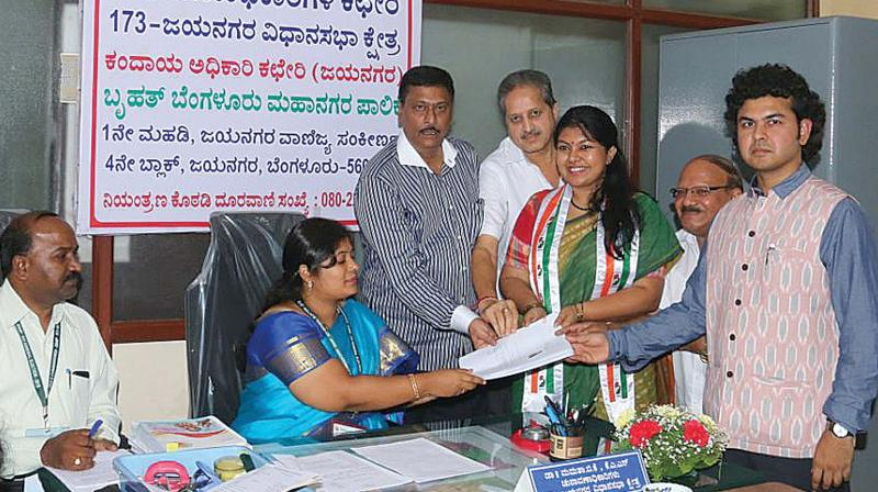 Congress candidate for Jayanagar constituency Sowmya Reddy files her nomination in Bengaluru on Saturday