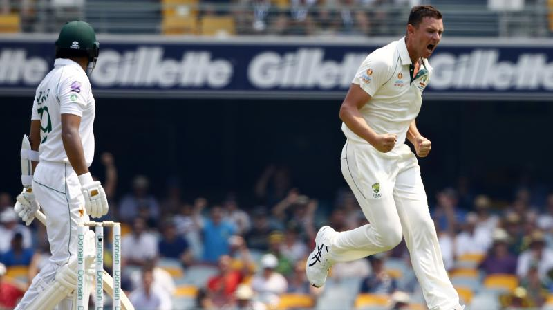 Josh Hazlewood and Pat Cummins led an Australian fight back as Pakistan lost five wickets for just 19 runs after lunch on the opening day of the first cricket Test at the Gabba on Thursday. (Photo:AP)
