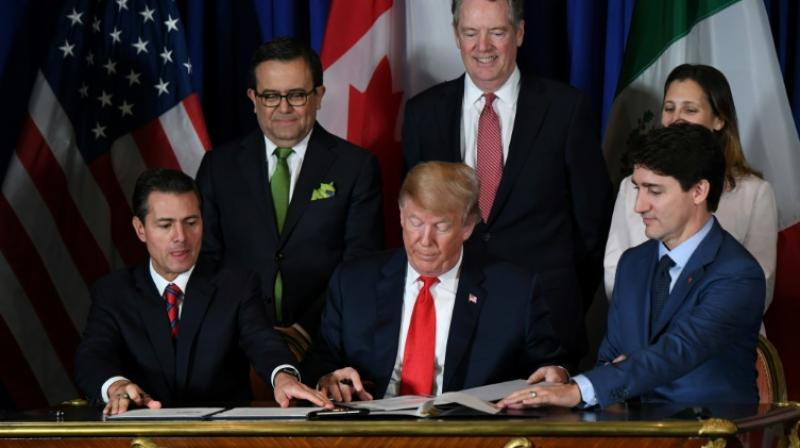 Trump claims win as US, Mexico, Canada sign new trade deal