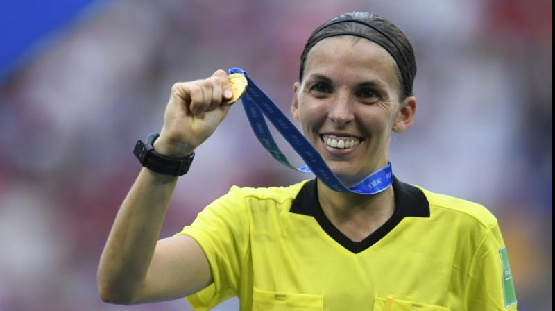 The 35-year-old created history domestically in France in April as she became the first female referee to officiate a men's Ligue 1 match, between Amiens and Strasbourg. (Photo:AFP)
