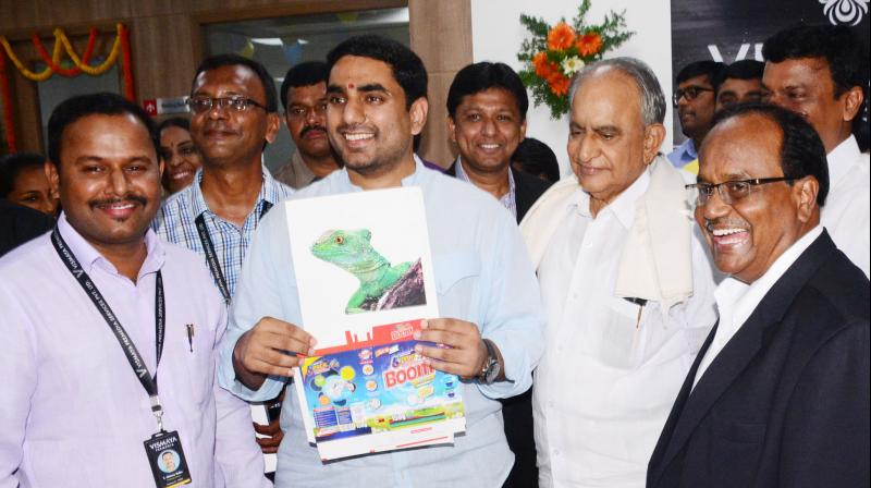 IT minister Nara Lokesh releases a poster in the presence of TD senior leader and MLC M.V.V.S. Murthi at the inauguration of software companies, Tech Hub - APEITA inside AP Cyber Towers in Visakhapatnam on Tuesday.