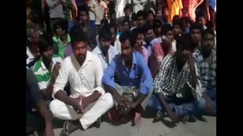 Villagers of Turlapadu took to the streets after a 35-year-old woman was allegedly molested by two men. (Photo: ANI)