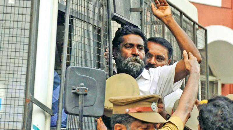 Mugilan outside Chief Metropolitan Magistrate Court in Egmore.	—DC