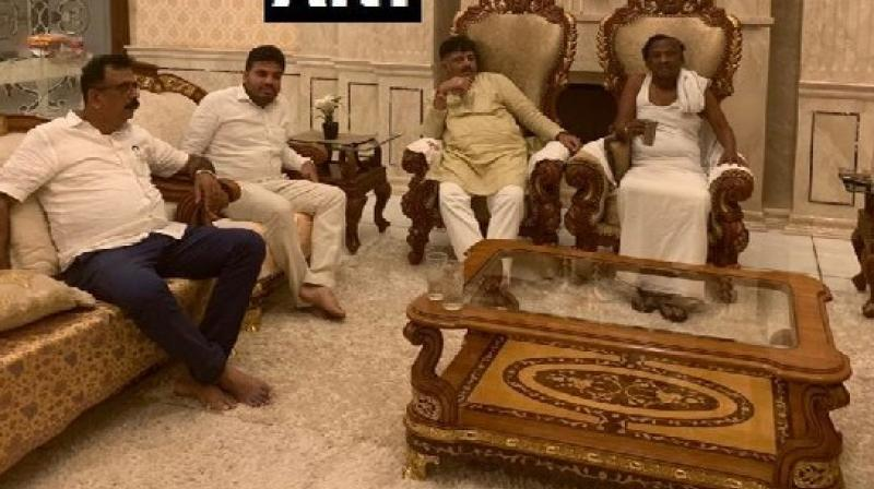 Amid ongoing political turmoil in Karnataka, Congress leader D K Shivakumar visited the residence of Congress MLA and state minister MTB Nagaraj early on Saturday morning to convince him to take back his resignation. (Photo: Twitter/ ANI)