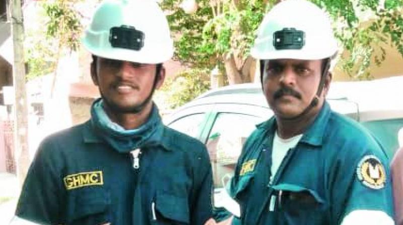GHMC's disaster relief personnel hold the rescued kittens.