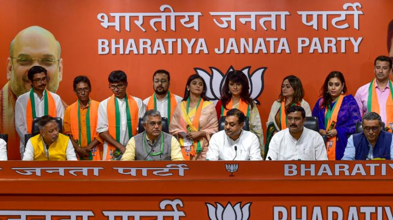 Several Bengali actors, including Parno Mittra, joined the BJP here on Thursday in presence of party leaders, including its West Bengal unit head Dilip Ghosh and senior functionary Mukul Roy. (Photo: PTI)