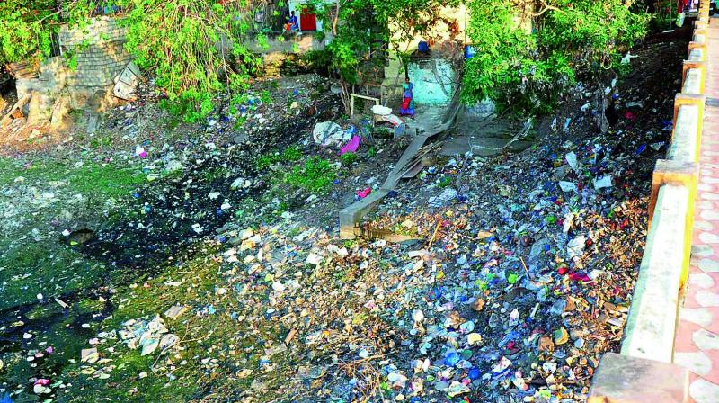 File photograph of garbage dumped into one of the three canals that flow through Vijayawada.