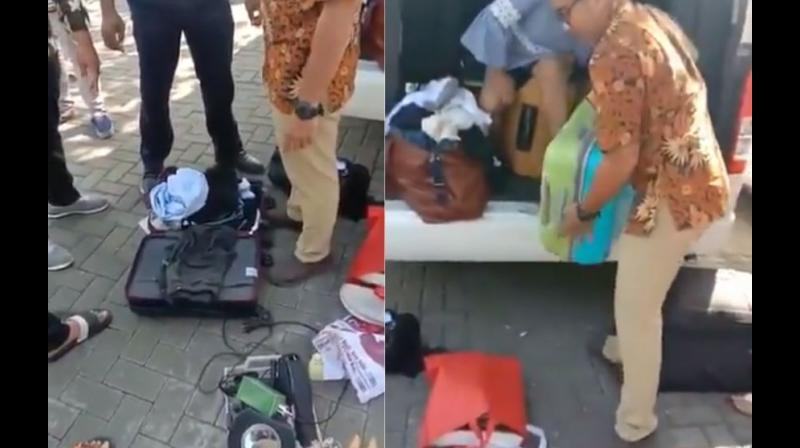 In the video a woman can be seen arguing with the officials from the hotel who seem to be vigorously going through the suitcases