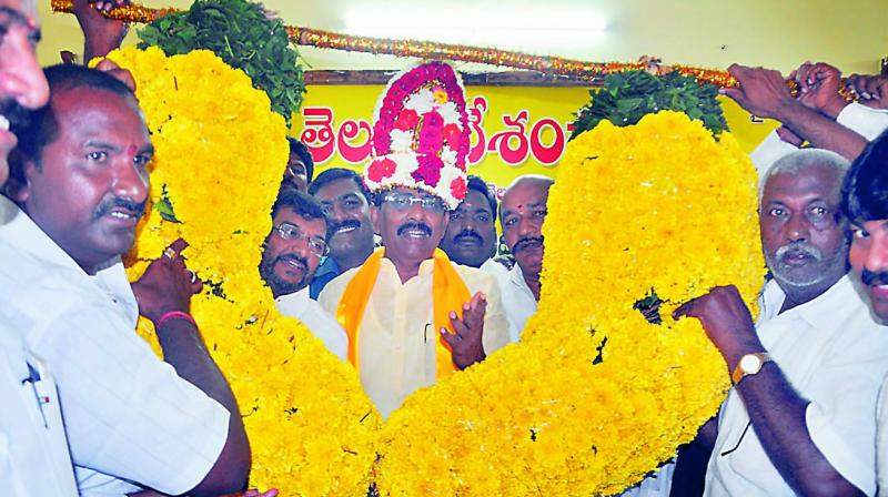 TDP activists felicitate Vakati Narayana Reddy, who won MLC local bodies seat in Nellore with a margin of 87 votes. (Photo: DC)