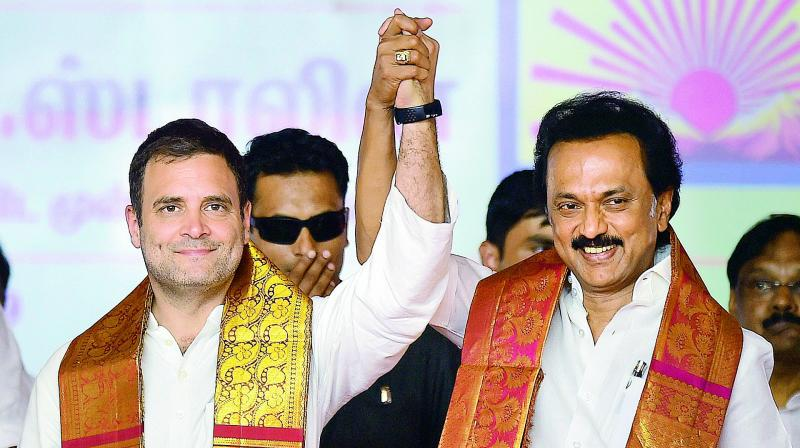Congress chief Rahul Gandhi with Dravida Munnetra Kazhagam (DMK) chief M.K. Stalin during an election campaign in Salem on Friday. (Photo: PTI)