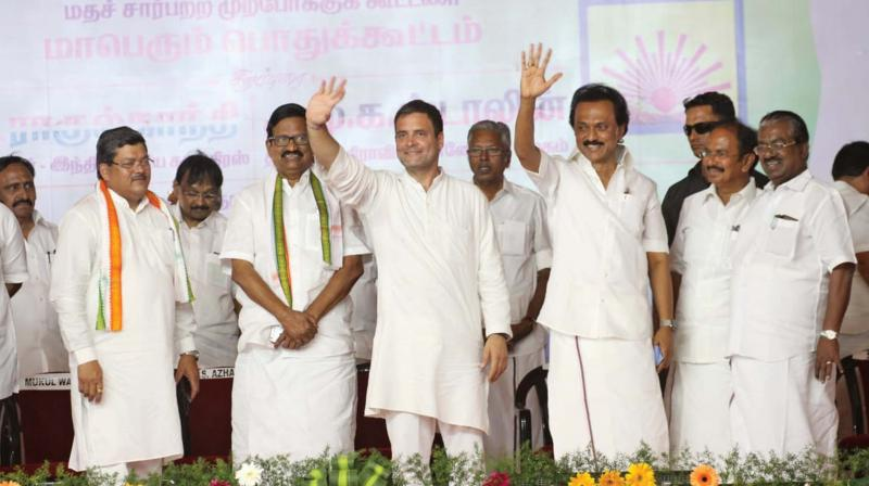 Poll allies Rahul Gandhi and M.K. Stalin wave at people on their UPA election campaign in Salem on Friday. (Image DC)