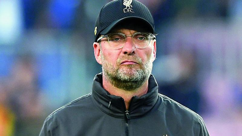 Liverpool manager Juergen Klopp said it was too soon to decide exactly how his team will play two games in 24 hours in England and Qatar but it was time to address the regular fixture pile-ups facing top clubs. (Photo:File)