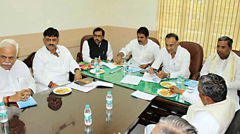 Congress leaders Siddaramaiah, Dr G. Parameshwar, D.K. Shivakumar,  R.V. Deshpande, Dinesh Gundurao and K.C. Venugopal at  a meeting in the city on Wednesday