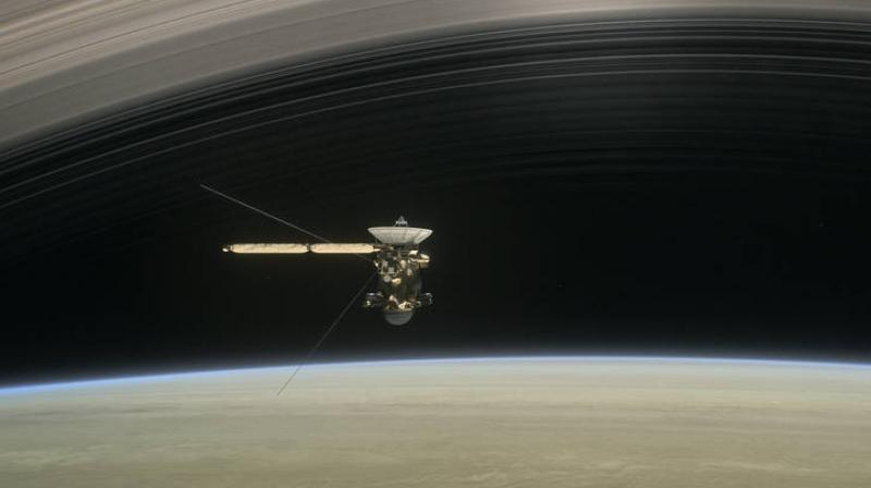 This artist's rendering shows Cassini as the spacecraft makes one of its final five dives through Saturn's upper atmosphere in August and September 2017. (Credits: NASA/JPL-Caltech)