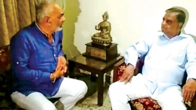 A file photo of Congress leader A. Manju with BJP leader V. Srinivas Prasad.