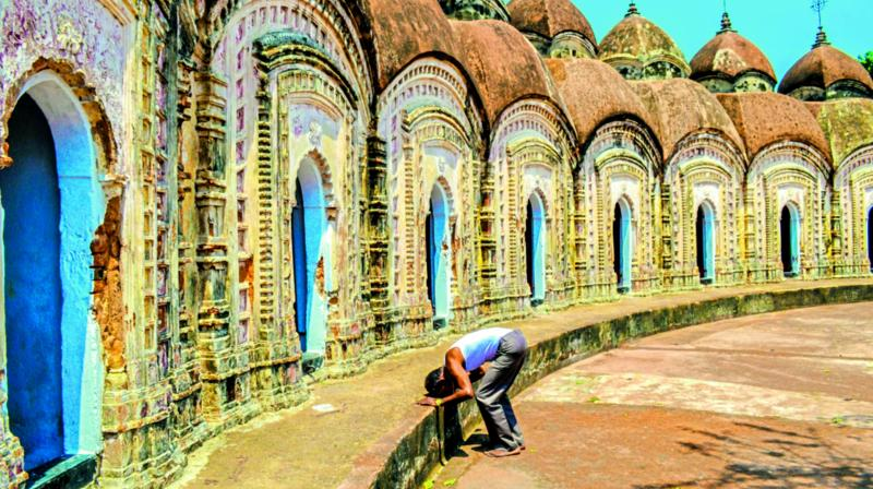 A man bows his head and prays at the Shiva Temples of Burdwan.