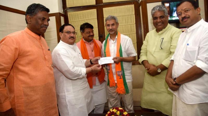 External Affairs Minister Subrahmanyam Jaishankar on Monday formally joined Bharatiya Janata Party (BJP) in the presence of working president J P Nadda at Parliament House. (Photo: Twitter/ ANI)