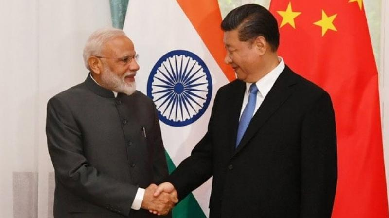 PM Modi, Xi and Russian President Vladimir Putin met at the recently held Shanghai Cooperation Organisation (SCO) summit at Kirgiz capital Bishkek. (Photo: Twitter/ @PIB_India)