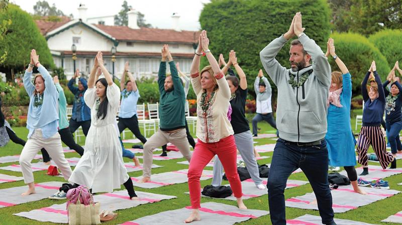 Overseas guests take yoga lessons at a hotel in Ooty.	—DC