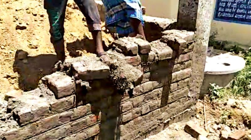 Group of youngsters pull down wall of an anganwadi.