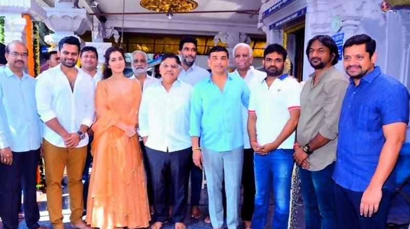 Sai Tej, Raashi Khanna, Allu Aravind and Maruti at the film's launch