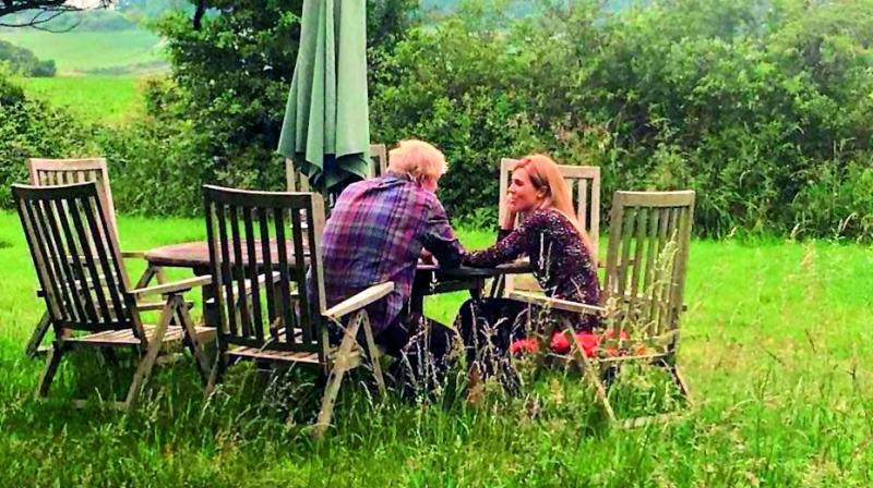 This photograph of Borish Johnson with his girlfriend was circulated before his question-answer session. The timing of the 'leak' was widely questioned by the British media in the backdrop of the row that the couple had, where the police had to be called in. 	–Metro