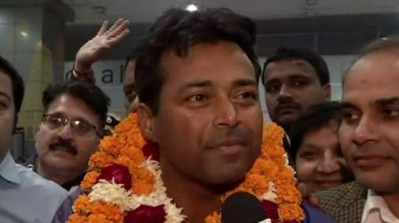 Leander Paes paired with debutant Nedunchezhiyan bettered his own Davis Cup record by winning his 44th doubles match against teenagers Mohammed Shoaib and Hufaiza Abdul Rehman 6-1, 6-3 in just 53 minutes. (Photo: ANI)