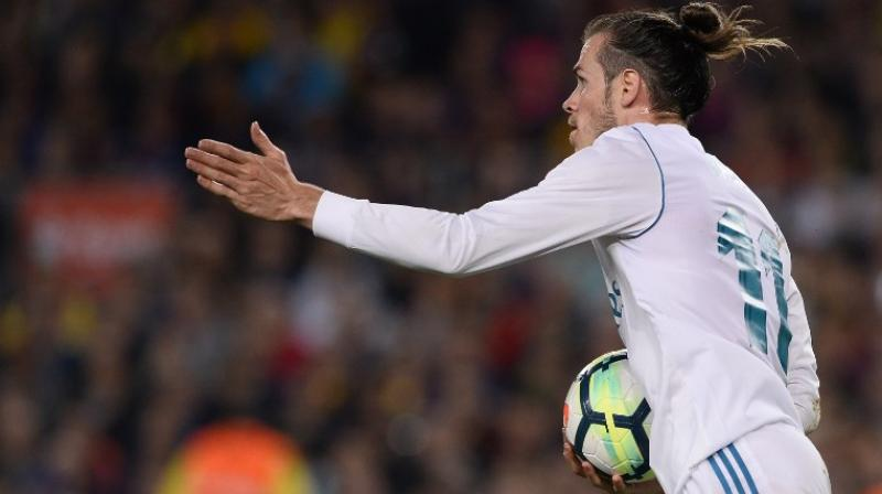 This was the first 'Clasico' in a decade which had no bearing on the title race but the game was still played with all the usual passion and tension which makes it the most famous club fixture in Europe. (Photo: AFP)