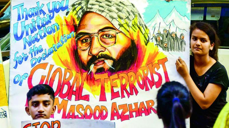 Students hold up posters as JeM head Masood Azhar was blacklisted by UN Security Council committee in Mumbai  on Thursday.  (PTI)