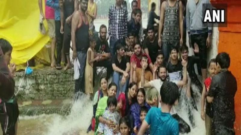 Meanwhile, normal life has been affected in Barwani as the relentless rain has battered the district, submerging the Rajghat Bridge. (Photo: ANI)