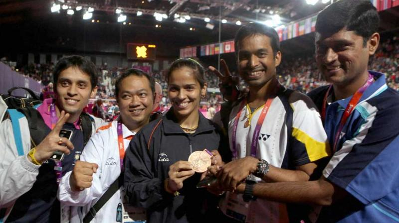 """""""She (Saina Nehwal) is India's top player and someone whom I have trained for 10 years. It's nice that she has decided to come back home,"""" said coach Pullela Gopichand. (Photo: PTI)"""
