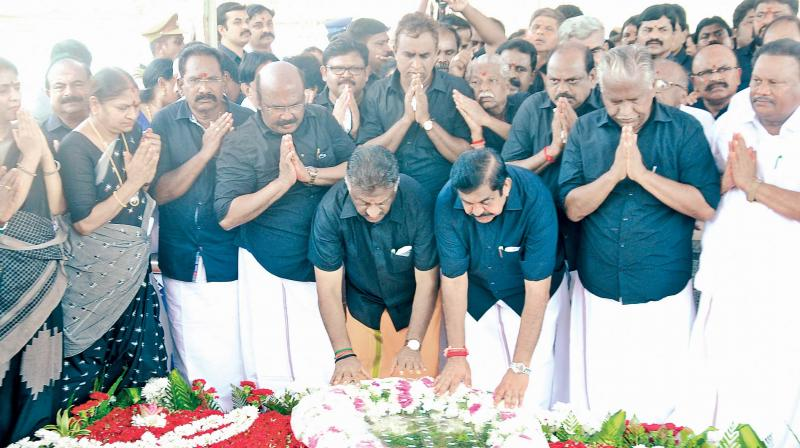 Chief Minister Edappadi K. Palaniswami and his deputy O. Panneerselvam along with senior ministers and AIADMK cadres paid floral tribute to late Chief Minister J Jayalalithaa's second death anniversary at her memorial in Marina. (Photo: DC)