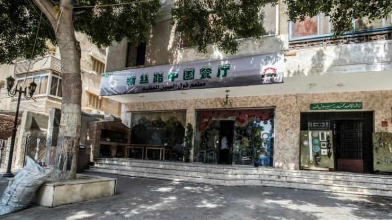 He was picked up in broad daylight with friends, and taken to a Cairo police station where Chinese officials grilled him about what he was doing in Egypt. (Photo: AFP)