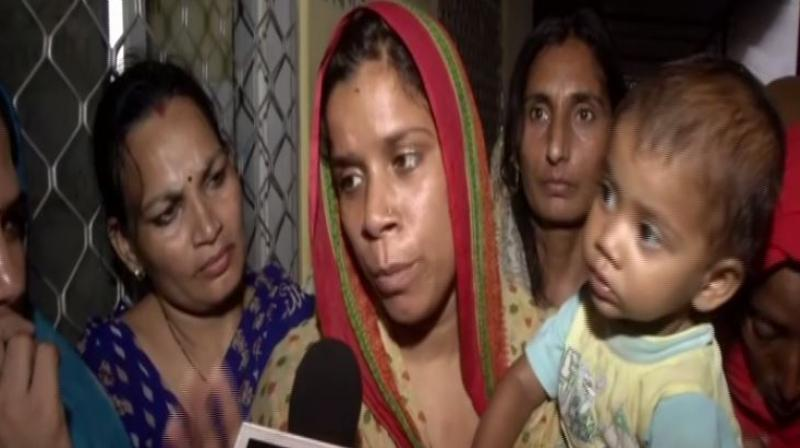 They are agitating with the body of Rekha's father-in-law who the family says consumed poison due to police apathy in the case of his son's death. (Photo: ANI)